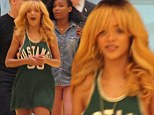 The original bad girl! Smiling Rihanna wears basketball vest in Barcelona as rapper Wale premieres their new track on the radio