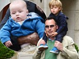 Daddy daycare! David Furnish dotes on his and Elton John's mini-mes on holiday in Venice