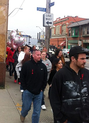 People walk during a rally for Michelle Knight on May 11, 2013, in Cleveland.