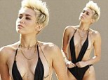 Taking fashion tips from Borat? Miley Cyrus leaves little to the imagination in barely-there monokini on single cover art