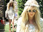 She is her father's daughter! Kimberly Stewart opts for a 1960's inspired flower-power frock as she attends Kim Kardashian's baby shower