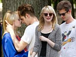 Young love: Emma Stone and Andrew Garfield shared a tender moment on Sunday on the set of The Amazing Spider-Man 2 in New York City