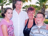 Family man: Stewart Fleming with his wife Sarah, daughter Lauren and son Matthew