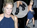 Ain't that a kick! Rachel Hunter steps out to West Hollywood nightclub in asymmetrical leather boots and flesh-flashing backless dress