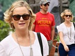 A funny pair: Comedians Seth Meyers and Amy Poehler go for a sunday stroll to Starbucks