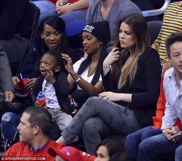 Fired: A glum looking Khloe watched husband Lamar Odom play at the LA Clippers versus Memphis Grizzlies game Monday after Fox announced she would not be returning as The X Factor host next season