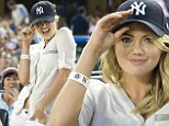 All-American girl! Supermodel Kate Upton cheers for the Yankees in tiny white shorts