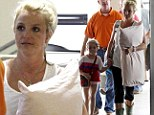 Time for a nap? Make-up free Britney Spears looks exhausted as she walks through airport in New Orleans with cute niece and a couple Jamies