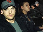 Dude, why so glum? Ashton Kutcher's downcast as he heads out with his leading lady Mila Kunis for Dim Sum