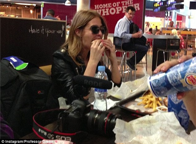 Roughing it: Prof Green posted a photo of his fiancee Millie Mackintosh eating a Burger King meal in Malaga airport on Friday morning