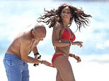 Tending to her every need: Stephen Belafonte rubbed sun tan oil into every inch of his wife Mel B's body as she celebrated her birthday on the beach in Malibu