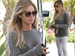 Keeping a low profile: Ashley Tisdale goes make-up free and wears a casual grey outfit to fill up her car at a petrol station