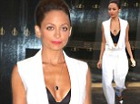 Decked-out decolletage! Nicole Richie dons a revealing white pantsuit that falls open to a sexy black bustier