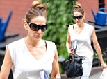 Working mother Sarah Jessica Parker rushes home from the shops with a bag full of organic food for her family