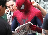 Reading the paper: Andrew in his Spider-Man outfit read the New York Post on Monday