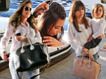 Khloe and Kourtney Kardashian wear nearly identical outfits on their way to family dinner... while Kim trails behind in flip flops