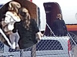 Next stop, Paris! Brad Pitt and Angelina Jolie board their private jet ready for French premiere of zombie flick World War Z