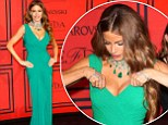 Showing off her assets! Green goddess Sofia Vergara makes sure all eyes, including her own, are on her famous curves and expensive jewels at the CDFA Fashion Awards
