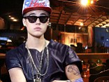 Bieber is reported to have been 'mobbed' by girls as he visited nightclub Mansion for a hip-hop party.