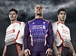 Away strip: Liverpool's new second kit displayed by Steven Gerrard, Luis Suarez and Pepe Reina