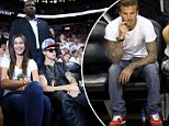 The soccer star and the diva: David Beckham catches a basketball game as Justin Bieber demands the star treatment
