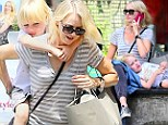 He ain't heavy, he's my boy! Naomi Watts gives her son a piggyback around New York