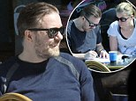 Ricky Gervais and long-term partner Jane Fallon enjoyed the sunshine as they looked through a script together
