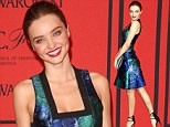 Blue belle! Heavenly Miranda Kerr shines in a gorgeous patterned dress at the Fashion Awards in the Big Apple