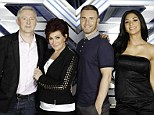 Let the battle begin: Sharon Osbourne takes her place alongside fellow X Factor judges Louis Walsh, Gary Barlow and Nicole Scherzinger