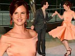 Showing off the goods! Designer Zac Posen pirouettes Juliette Lewis in one of his vintage-style dresses at the CFDA Awards