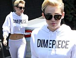 She's white hot! Miley Cyrus bares toned midriff in skintight leggings as she heads to recording studio