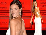What an angel! Alessandra Ambrosio is a vision in white as she flaunts her tanned and toned back at the CDFA Awards