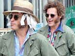 It will make your hair curl! Joaquin Phoenix gets into character with curling rags and mutton chops on the set of Inherent Vice