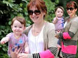 Smiles to match! Alyson Hannigan and her baby daughter beam as they take a stroll in evergreen Los Angeles