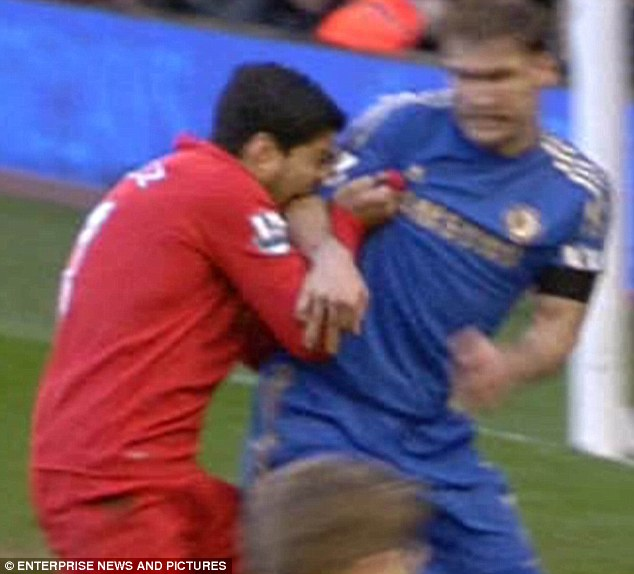 Ouch: Luis Suarez bit Chelsea defender Branislav Ivanovic during the match on Sunday