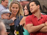 School reunion! Elizabeth Berkley takes baby Sky to watch her Saved By The Bell on-screen boyfriend Mario Lopez host Extra