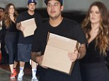 Keeping up with the 'fat boy'! Rob Kardashian looks to bolster his public image as he drags Khloe to view his latest sock designs