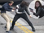 Call the Black Widow! Chris Evans' Captain America struggles during fight scene with the Winter Soldier as filming with Scarlett Johansson continues