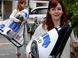 Alyson Hannigan carrying a space shuttle toy in Brentwood, California