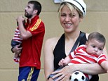 Her little footballer! Mensa-certified genius Shakira holds baby Milan and his toy soccer ball