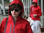 Ready for rain: Anne Hathaway wore a waterproof coat as she stepped out on a gloomy day in NYC with her husband Adam Shulman on Friday