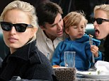 Are you going to eat that? Supermodel Karolina Kurkova steals a bite from son's burger during fun-filled family lunch