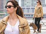 Dog day afternoon: Jessica Biel takes dogs for a walk along the Hudson wearing a stylish beige parka