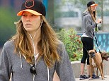 Jessica Biel shows off her pert derriere in tight workout pants as she takes her pooches for a walk