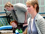 Cynthia Nixon goes bra-less in grey halter-dress to take son Max to the playground