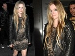 Snakeskin and leather! Avril Lavigne wears unique combo as she parties with male friends in London