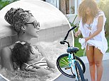 Her baby love! Beyoncé posts an intimate snap of her snuggling with Blue Ivy on a tropical vacation