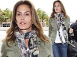 A weary traveler! Cindy Crawford arrives for a flight looking less than her usual supermodel self