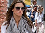 Family fun in the sun! Alessandra Ambrosio spends a leisurely Saturday shopping with fiancé Jamie Mazur and their daughter Anja
