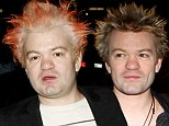 Deryck Whibley displays bloated face and dodgy flame-tipped hair at Tom Petty concert